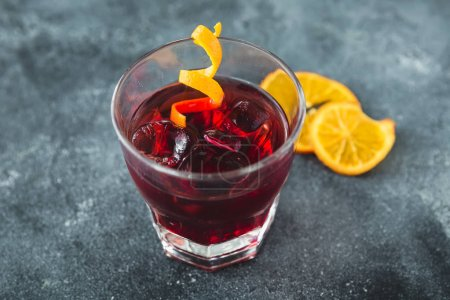 Alcoholic cocktail with orange. Alcoholic cold drink in bar