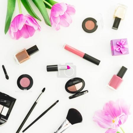 Photo for Frame of tulip flowers and cosmetics. Top view. Flat lay feminine desk. - Royalty Free Image