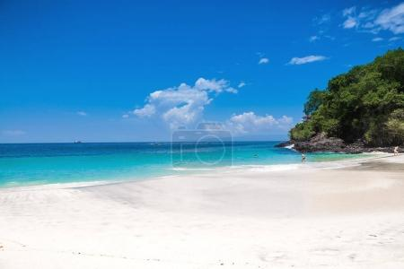 Tropical sandy beach and ocean with crystal water in Bali