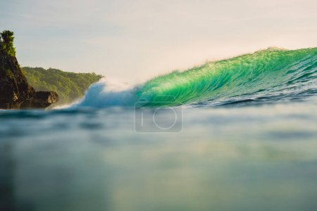 photo of beautiful clean sea wave on blue sky background
