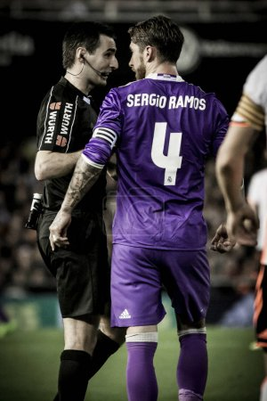 Ramos talks with referee