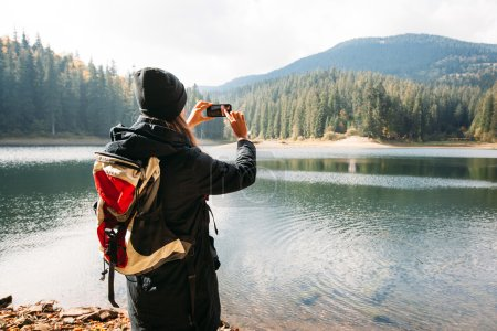 Photo for Hands taking a picture of a nature with a smart phone - Royalty Free Image