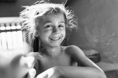 Photo for Child girl smiling and playing - Royalty Free Image