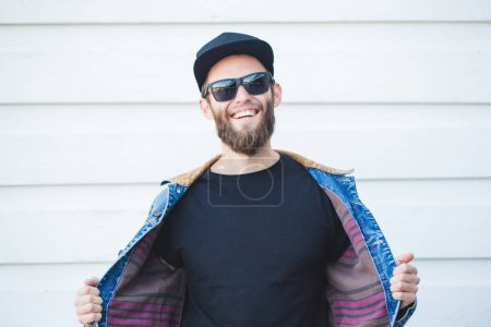 Hipster handsome male model with beard  wearing black blank t-sh