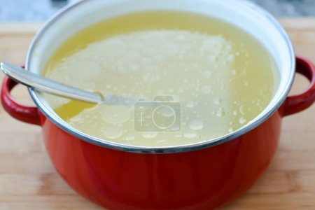 Homemade chicken stock or broth in a pot
