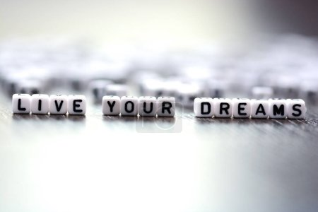 Live your dreams advice spelled by plastic letter beads