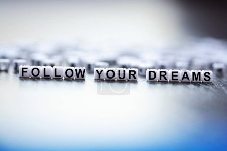 Follow your dreams text made from plastic letter beads