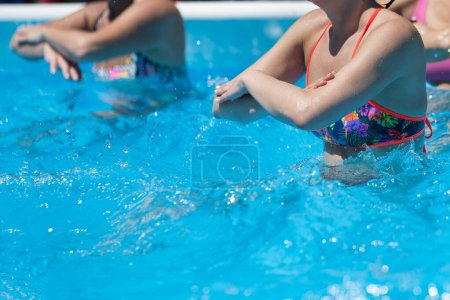 Photo for Women Doing Water Aerobics Outdoor in a Swimming Pool. - Royalty Free Image