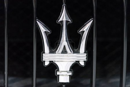 Maserati metallic emblem closeup