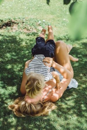 Mother having fun with her son on grass
