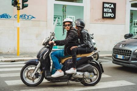 Man and woman on motorbike