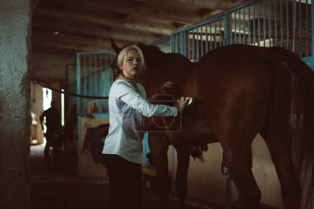girl takes care of horse