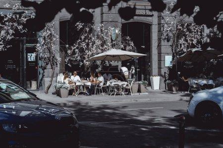 People having meal in street cafe