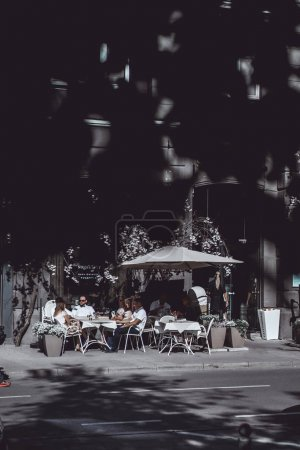 People having meal in street cafe