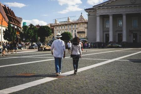 couple walking in central square