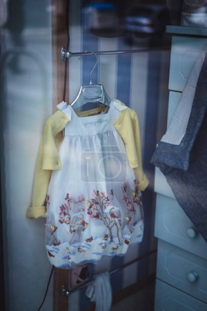 cute child dress hanging at room