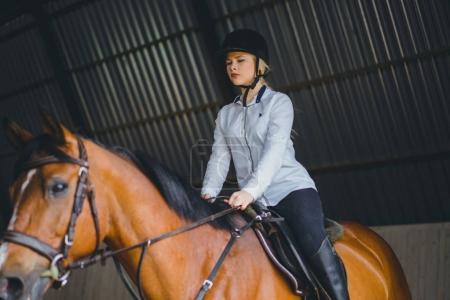 Girl sitting on horseback