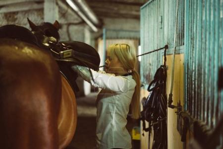 Girl taking care of horse