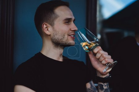Smiling man drinking wine