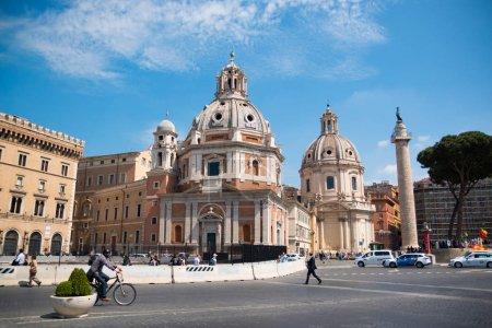 ROME, ITALY - 13.04.2017: Imperial Forum Traian Column and Chiesa del Santissimo Nome di Maria in Rome