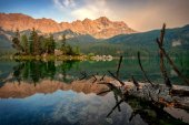 Mountain peak Zugspitze. Summer day at lake Eibsee near Garmisch Partenkirchen. Bavaria, Germany