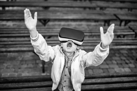 Little boy in virtual reality glasses