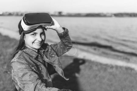 Young girl in virtual reality glasses