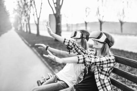 girls enjoy virtual reality glasses