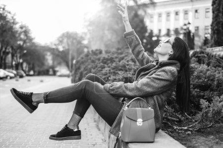 brunette girl sitting outdoor