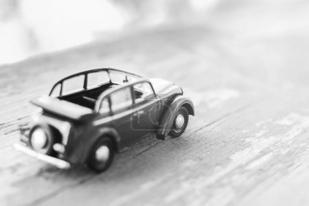 Toy little car on wooden background