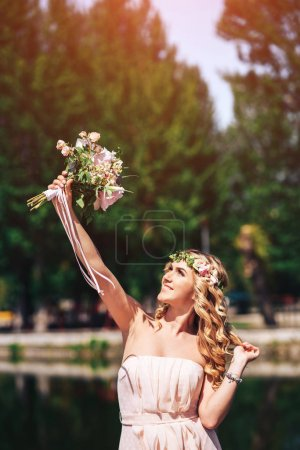 Young bride with wedding bouquet