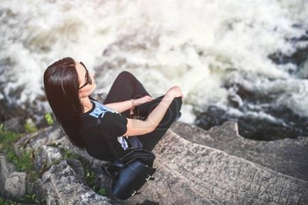 Young girl near mountain river
