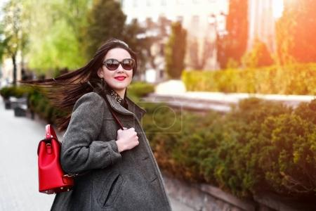Woman with red backpack in hands