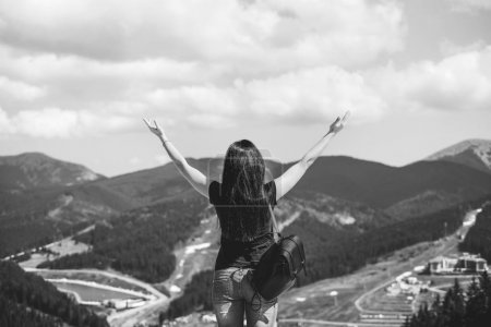 Young tourist girl enjoy nature on the top of the mountain