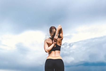 sporty girl showing stretching