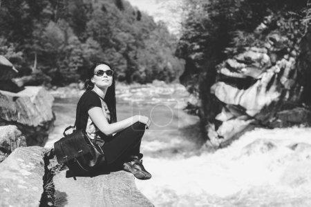 tourist girl near mountain river