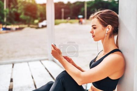 sporty girl relaxing listening music