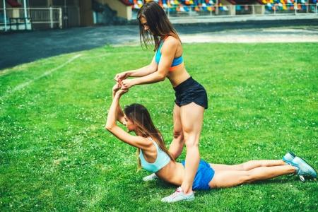 sporty women workout together