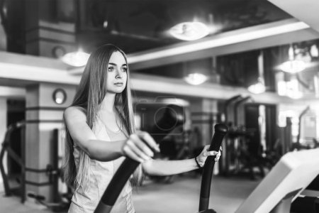 young woman training in gym