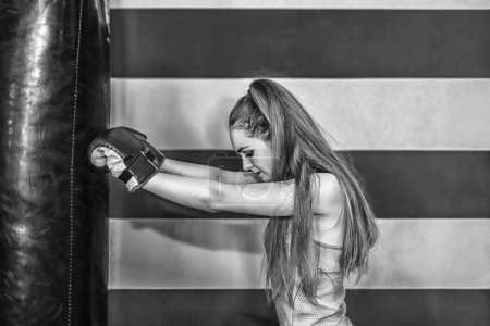 sporty girl boxing in gym