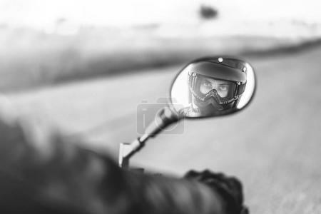 Man looking into rear view mirror