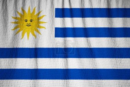 Photo pour Gros plan du drapeau de l'Uruguay froissé, drapeau de l'Uruguay soufflant dans le vent - image libre de droit