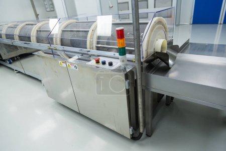 big steel chromed machine with control panel