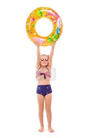 Cute girl with colorful rubber ring