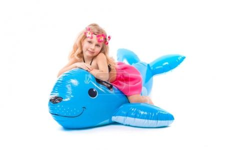 Cute girl on blue inflatable seal