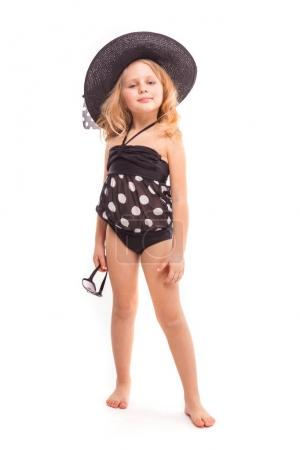 Little blonde girl in black swimwear
