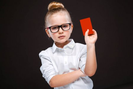 Girl in white blouse with red card