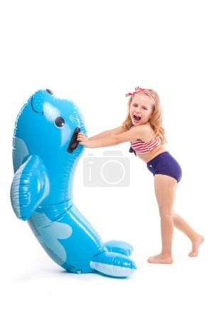 Cute girl with blue inflatable seal