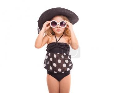 Little blonde girl in black swimwear