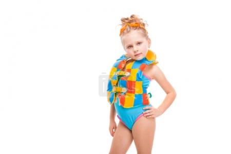 Girl in swimsuit and life jacket